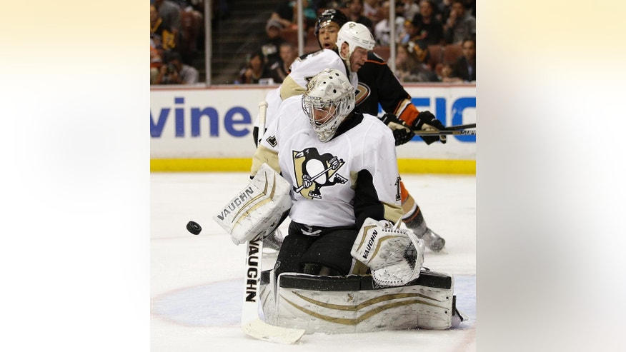 Pittsburgh Penguins goalie Thomas Greiss, of Germany, deflects the puck during the second period of an NHL hockey game against the Anaheim Ducks, Friday, March 6, 2015, in Anaheim, Calif. (AP Photo/Jae C. Hong)
