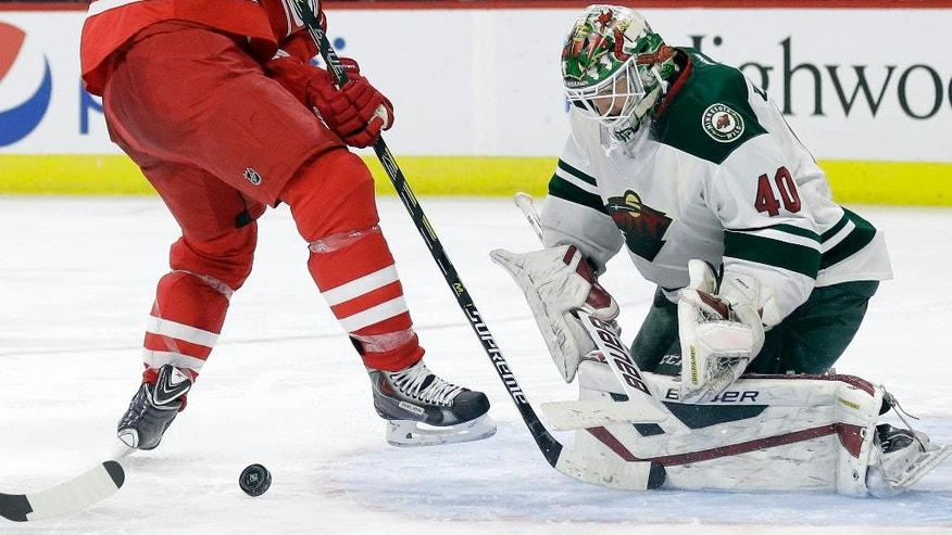 Carolina Hurricanes' Jordan Staal, left, tries to score against Minnesota Wild goalie Devan Dubnyk (40) during the second period of an NHL hockey game in Raleigh, N.C., Friday, March 6, 2015. (AP Photo/Gerry Broome)
