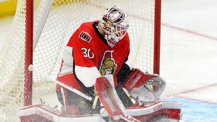 Ottawa Senators' Andrew Hammond (30) makes a save against the Buffalo Sabres during the second period of an NHL hockey game, Friday, March 6, 2015 in Ottawa, Ontario. (AP Photo/Canadian Press, Justin Tang)