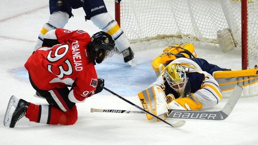 Ottawa Senators' Mika Zibanejad (93) puts pressure on Buffalo Sabres goaltender Anders Lindback (35) during the second period of an NHL hockey game, Friday, March 6, 2015 in Ottawa, Ontario. (AP Photo/Canadian Press, Justin Tang)