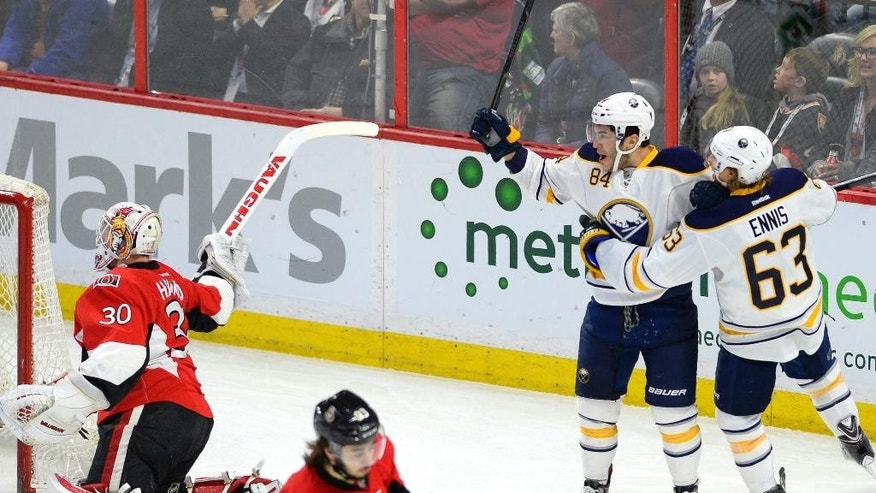Buffalo Sabres' Philip Varone (84) celebrates with teammate Tyler Ennis (63) on a goal against Ottawa Senators goaltender Andrew Hammond (30) during the first period of an NHL hockey game, Friday, March 6, 2015 in Ottawa, Ontario. (AP Photo/Canadian Press, Justin Tang)