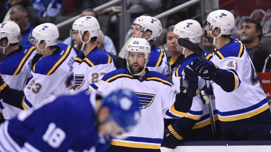 St. Louis Blues' Chris Butler (25) celebrates his shorthanded goal against the Toronto Maple Leafs with teammates during the second period of an NHL hockey game Saturday, March 7, 2015, in Toronto. (AP Photo/The Canadian Press, Frank Gunn)