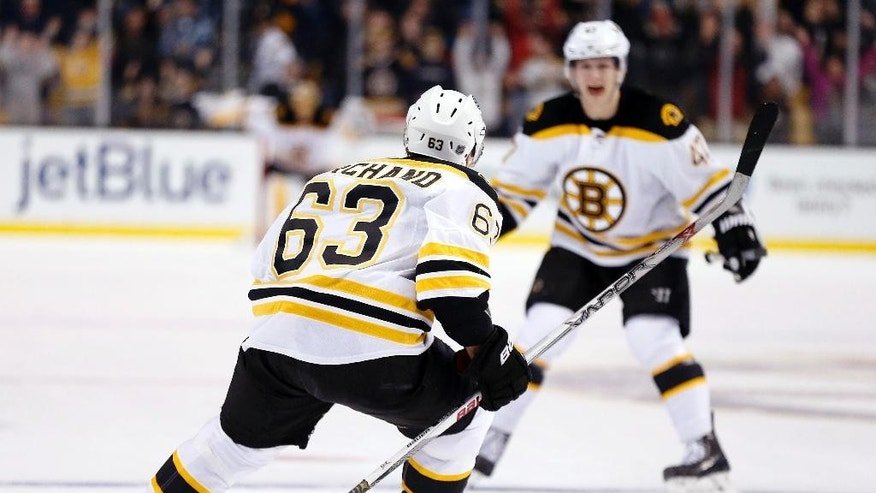 Boston Bruins' Brad Marchand (63) celebrates his game-winning goal with teammate Torey Krug (47) during overtime in an NHL hockey game against the Philadelphia Flyers in Boston, Saturday, March 7, 2015. The Bruins won 3-2. (AP Photo/Michael Dwyer)