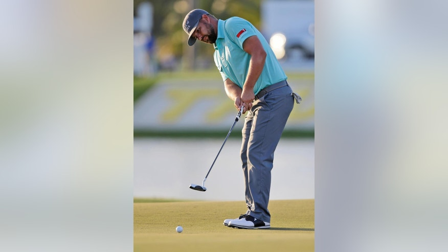 Ryan Moore putts on the ninth hole during the second round of the Cadillac Championship golf tournament, Friday, March 6, 2015, in Doral, Fla. (AP Photo/Wilfredo Lee)