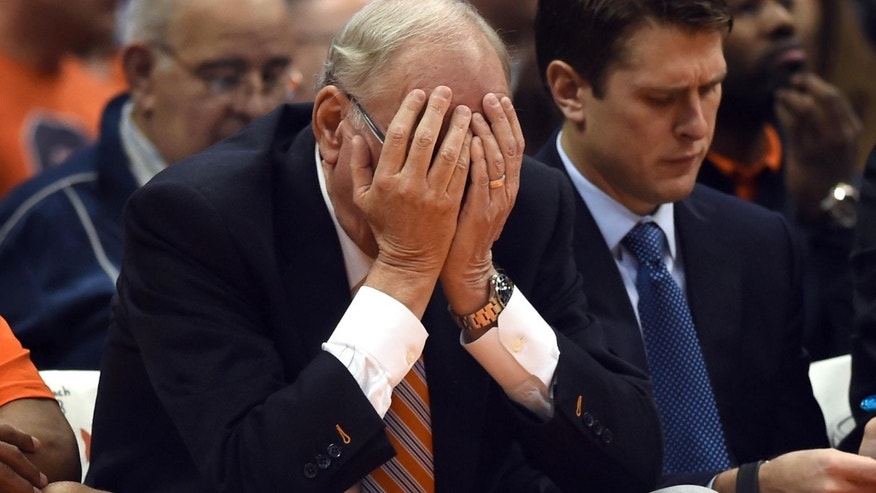 Nov. 25, 2014: Syracuse head coach Jim Boeheim buries his head in his hands after Rakeem Christmas is called for a foul against Loyola during the second half of an NCAA college basketball game