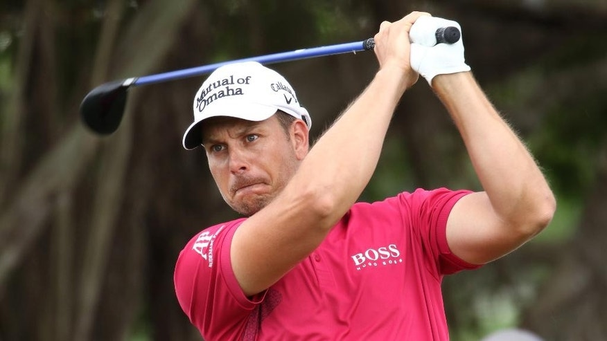 Henrik Stenson, of Sweden, hits from the fifth tee during the third round of the Cadillac Championship golf tournament Saturday, March 7, 2015, in Doral, Fla. (AP Photo/J Pat Carter)