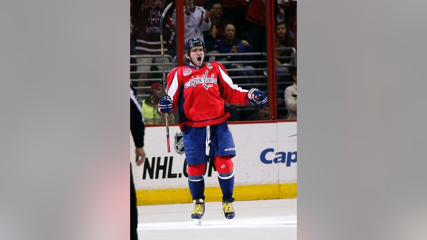 Washington Capitals left wing Alex Ovechkin (8), from Russia, celebrates his goal in the second period of an NHL hockey game against the Buffalo Sabres, Saturday, March 7, 2015, in Washington. (AP Photo/Alex Brandon)