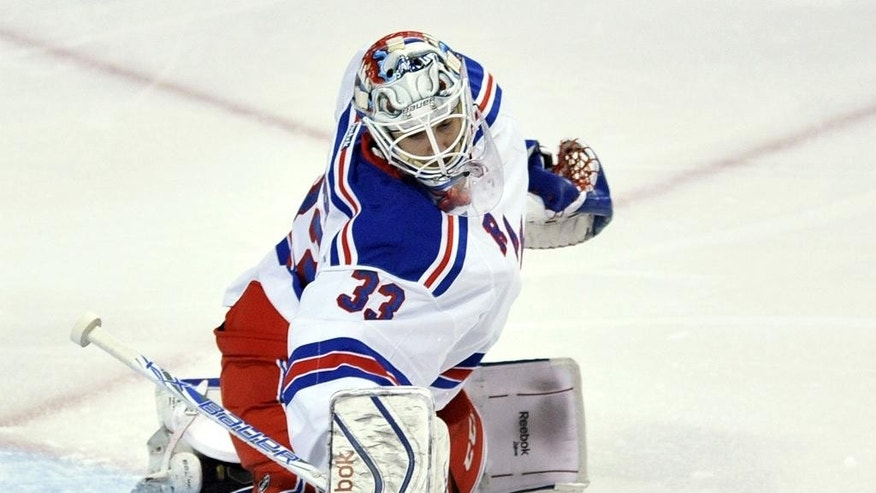 New York Rangers goalie Cam Talbot makes a save during the first period of an NHL hockey game against the Chicago Blackhawks, Sunday, March 8, 2015, in Chicago. (AP Photo/Paul Beaty)