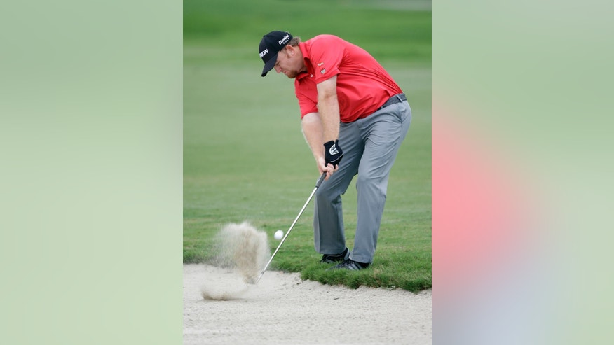 J B Holmes hits from a sand trap on the second fairway during the final round of the Cadillac Championship golf tournament Sunday, March 8, 2015, in Doral, Fla. (AP Photo/Wilfredo Lee)