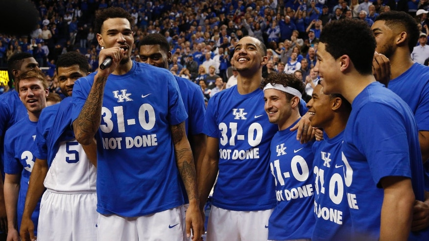March 7, 2015: Kentucky's Willie Cauley-Stein, third from left, address the crowd during a ceremony marking the teams undefeated season after an NCAA college basketball game.