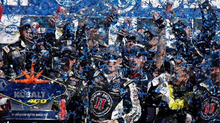 Kevin Harvick celebrates in victory lane after winning the Kobalt 400 NASCAR Sprint Cup series auto race Sunday, March 8, 2015, in Las Vegas. (AP Photo/Isaac Brekken)