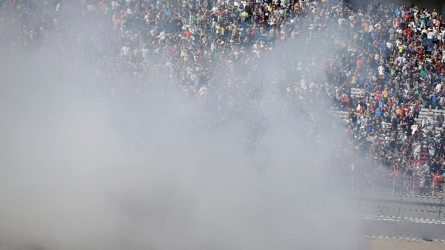 Kevin Harvick performs a burnout after winning a NASCAR Sprint Cup series auto race Sunday, March 8, 2015, in Las Vegas. (AP Photo/Isaac Brekken)