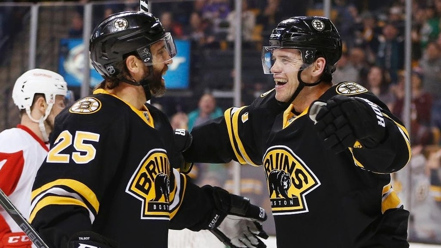 Boston Bruins' Daniel Paille, right, celebrates his second goal of the second period with teammate Max Talbot (25) during an NHL hockey game against the Detroit Red Wings in Boston, Sunday, March 8, 2015. (AP Photo/Michael Dwyer)
