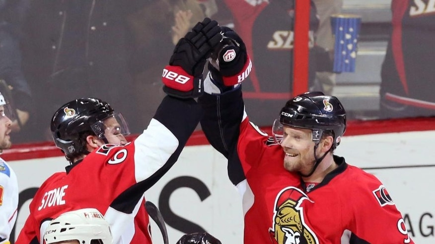 Ottawa Senator's Milan Michalek (9) celebrates his goal with teammate Mark Stone (61) during first period NHL hockey action against the Calgary Flames in Ottawa, Ontario, Sunday, March 8, 2015. (AP Photo/The Canadian Press, Fred Chartrand)