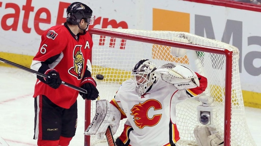 Ottawa Senators' Bobby Ryan (6) watches a goal by teammate Mike Hoffman (not shown) past Calgary Flames goaltender Karri Ramo during second period NHL hockey action in Ottawa, Ontario, Sunday, March 8, 2015. (AP Photo/The Canadian Press, Fred Chartrand)