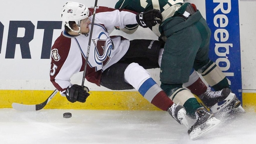Minnesota Wild defenseman Jonas Brodin (25) checks Colorado Avalanche right wing Dennis Everberg, left, of Sweden, during the first period of an NHL hockey game Sunday, March 8, 2015, in St. Paul, Minn. (AP Photo/Ann Heisenfelt)