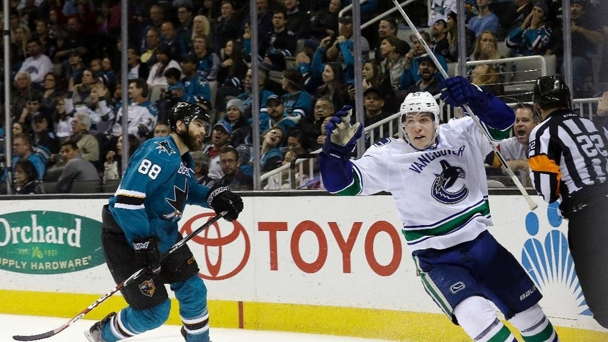 Vancouver Canucks center Bo Horvat, right, celebrates after scoring a goal, in front of San Jose Sharks defenseman Brent Burns (88) during the second period of an NHL hockey game in San Jose, Calif., Saturday, March 7, 2015. (AP Photo/Jeff Chiu)