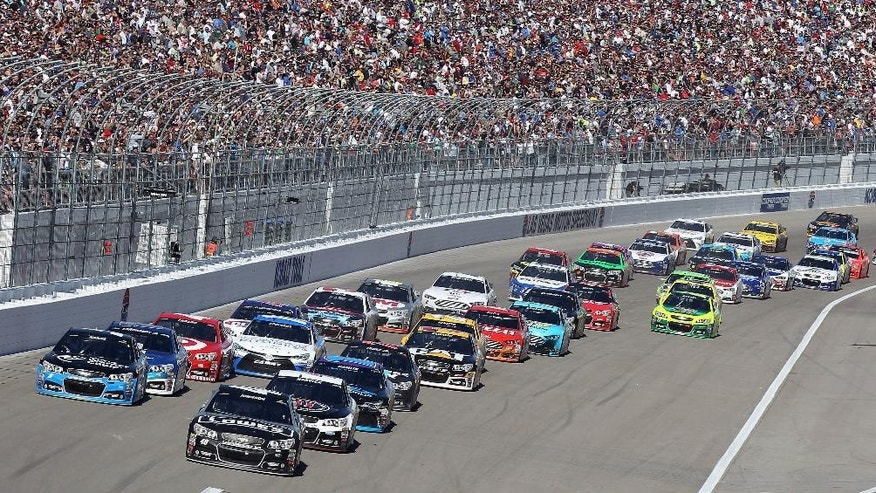 Jimmie Johnson, front right, leads during a restart at a NASCAR Sprint Cup series auto race Sunday, March 8, 2015, in Las Vegas. (AP Photo/Isaac Brekken)