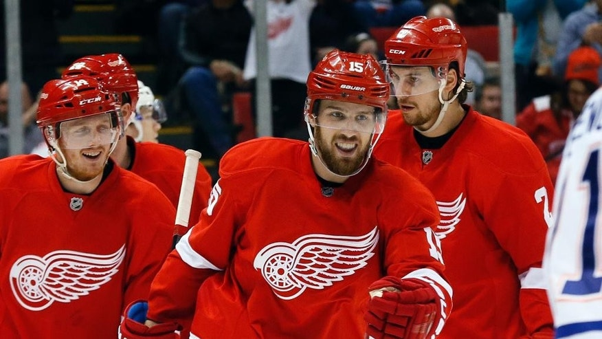 Detroit Red Wings center Riley Sheahan (15) celebrates his goal against the Edmonton Oilers in the second period of an NHL hockey game in Detroit Monday, March 9, 2015. (AP Photo/Paul Sancya)
