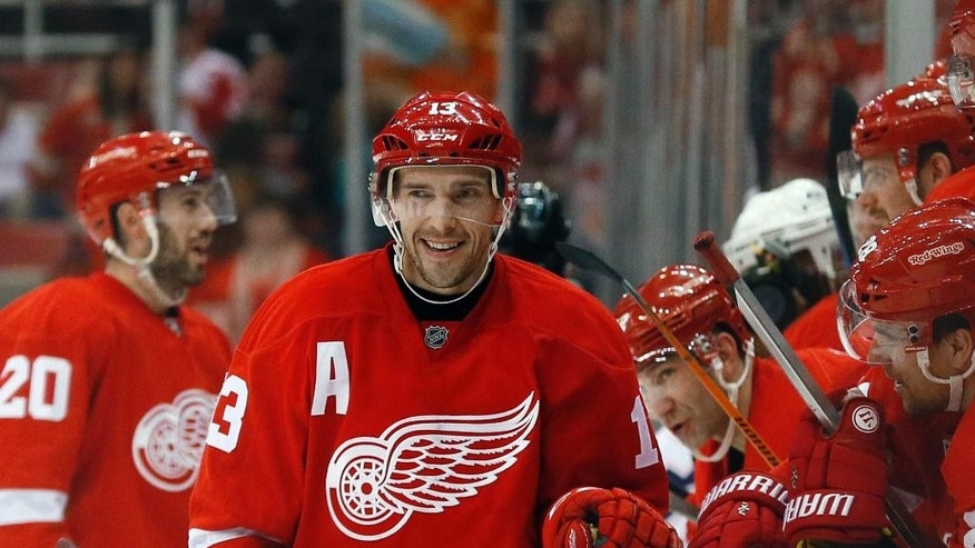 Detroit Red Wings center Pavel Datsyuk (13) celebrates his empty net goal against the Edmonton Oilers in the third period of an NHL hockey game in Detroit Monday, March 9, 2015. Detroit won 5-2. (AP Photo/Paul Sancya)