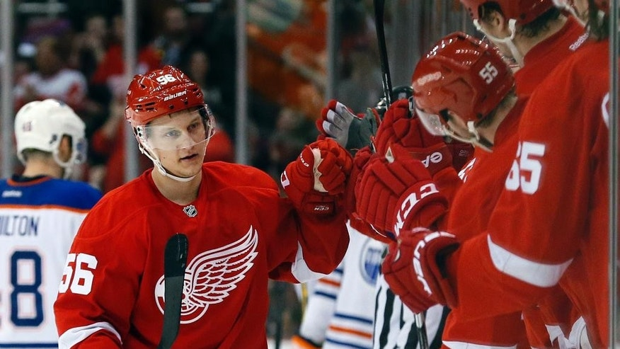 Detroit Red Wings left wing Teemu Pulkkinen (56) celebrates his goal against the Edmonton Oilers in the third period of an NHL hockey game in Detroit Monday, March 9, 2015. (AP Photo/Paul Sancya)