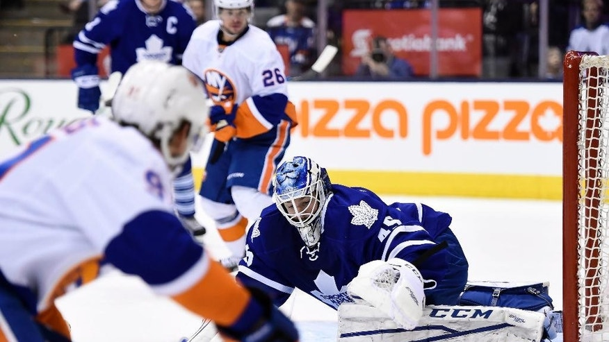 Toronto Maple Leafs goaltender Jonathan Bernier makes a save against the New York Islanders during the third period of an NHL hockey game Monday, March 9, 2015, in Toronto. (AP Photo/The Canadian Press, Frank Gunn)