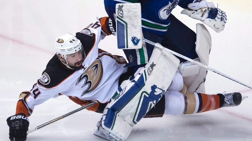 Anaheim Ducks center Nate Thompson (44) crashes into Vancouver Canucks goalie Eddie Lack (31) during the third period of an NHL hockey game Monday, March 9, 2015, in Vancouver, British Columbia. (AP Photo/The Canadian Press, Jonathan Hayward)