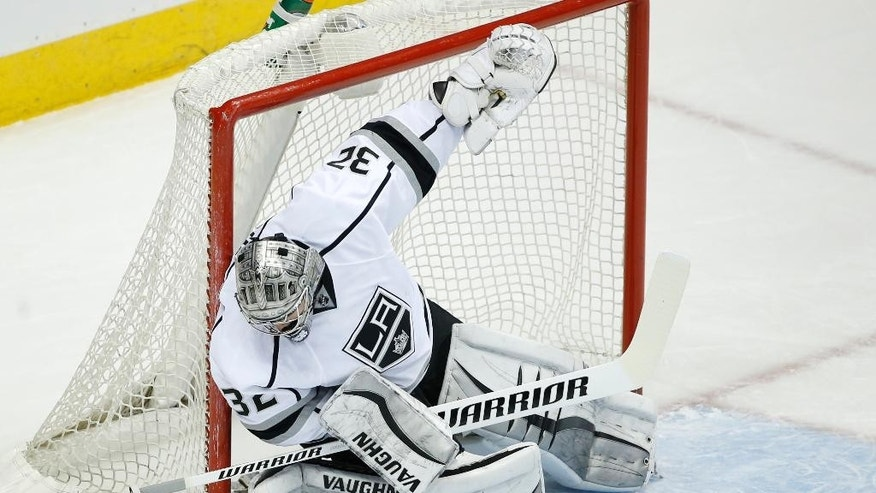 Los Angeles Kings goalie Jonathan Quick makes a save against the Colorado Avalanche during the first period of an NHL hockey game, Tuesday, March 10, 2015, in Denver. (AP Photo/Jack Dempsey)