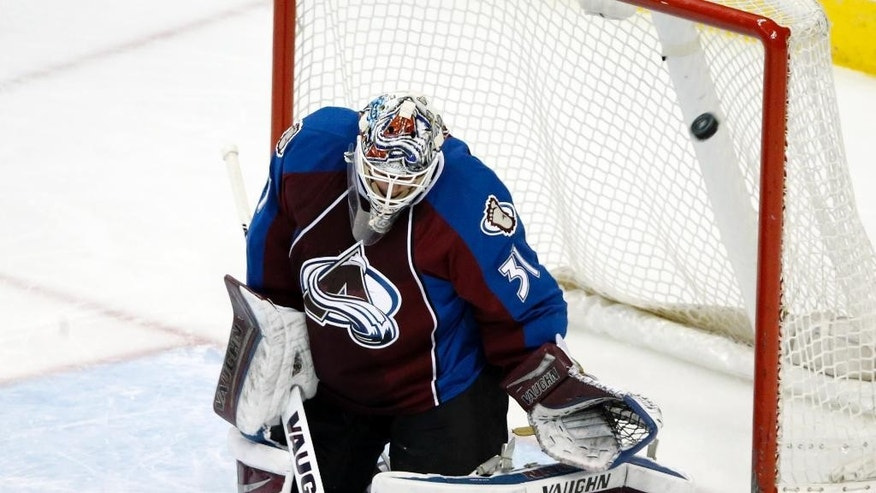 Colorado Avalanche goaltender Clavin Pickard lets a goal slip past against the Los Angeles Kings during the first period of an NHL hockey game, Tuesday, March 10, 2015, in Denver. (AP Photo/Jack Dempsey)