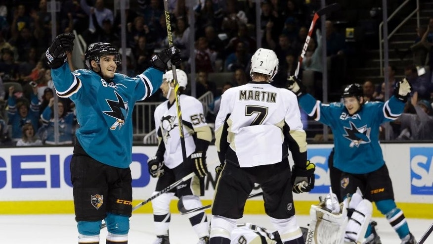 San Jose Sharks' Matt Nieto, left, celebrates after scoring next to Pittsburgh Penguins' Paul Martin (7) during the first period of an NHL hockey game Monday, March 9, 2015, in San Jose, Calif. (AP Photo/Marcio Jose Sanchez)