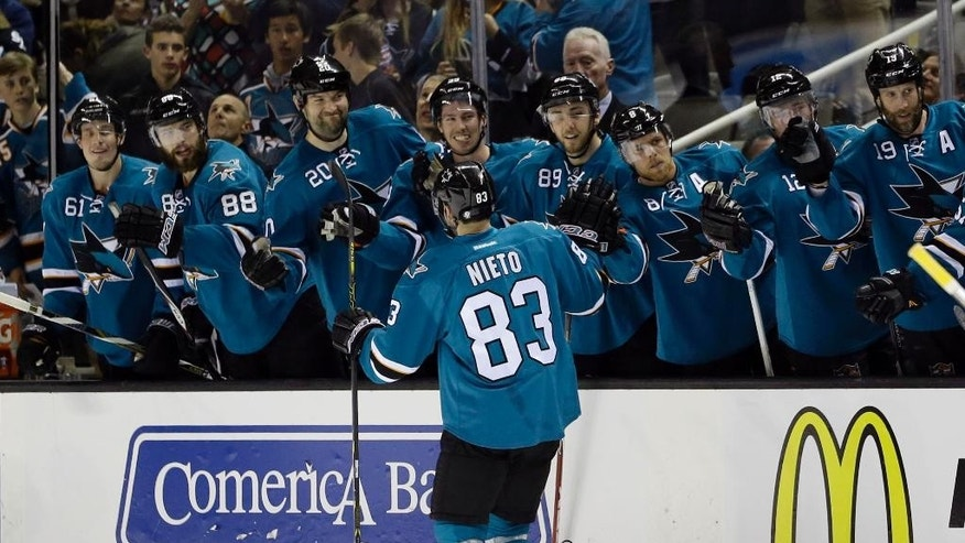 San Jose Sharks' Matt Nieto (83) celebrates his goal with teammates on the bench during the first period of an NHL hockey game against the Pittsburgh Penguins Monday, March 9, 2015, in San Jose, Calif. (AP Photo/Marcio Jose Sanchez)