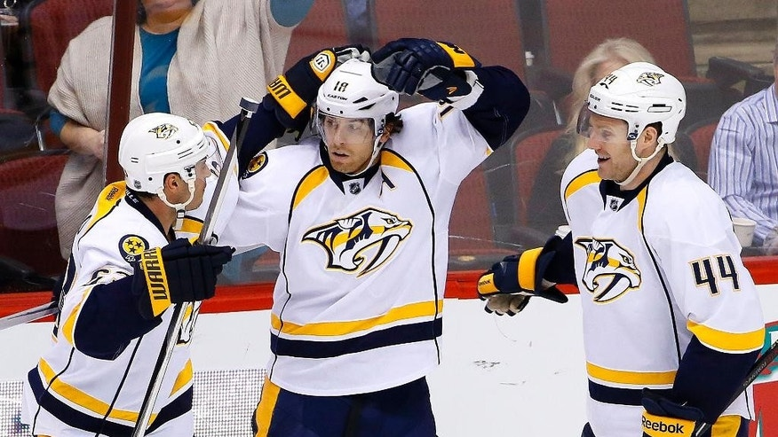 Nashville Predators' James Neal, center, celebrates his game-winning goal against the Arizona Coyotes with Cody Franson (44) and Mike Ribeiro, left, during overtime of an NHL hockey game Monday, March 9, 2015, in Glendale, Ariz.  The Predators defeated the Coyotes 2-1 in overtime. (AP Photo/Ross D. Franklin)