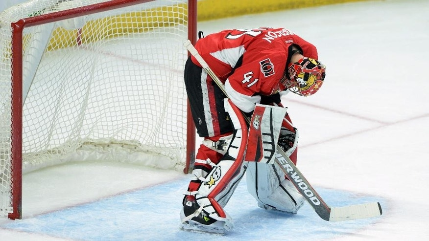 Ottawa Senators' Craig Anderson looks to the ice as he takes on the Boston Bruins during second period NHL hockey action in Ottawa, Ontario, on Tuesday, March 10, 2015. (AP Photo/The Canadian Press, Sean Kilpatrick)