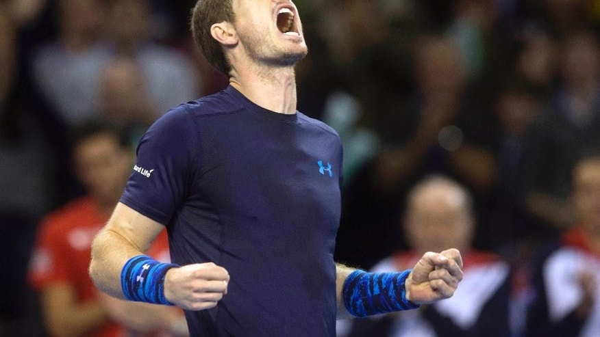 Britain's Andy Murray celebrates his victory against John Isner of the U.S, after their Davis Cup tennis match at the Emirates Arena, Glasgow, Scotland, Sunday, March 8, 2015. (AP Photo/Jeff Holmes, PA Wire)       UNITED KINGDOM OUT       -     NO SALES     -     NO ARCHIVES