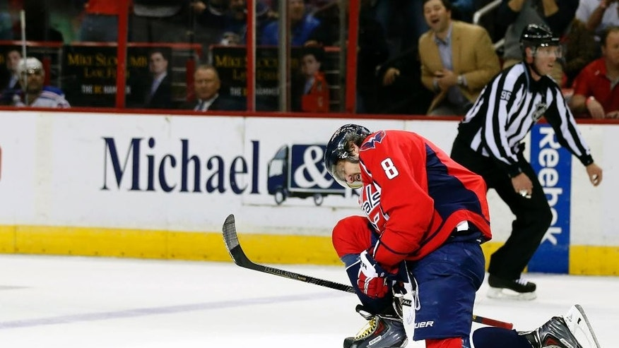 Washington Capitals left wing Alex Ovechkin, from Russia, celebrates his goal in the first period of an NHL hockey game against the New York Rangers, Wednesday, March 11, 2015, in Washington. (AP Photo/Alex Brandon)