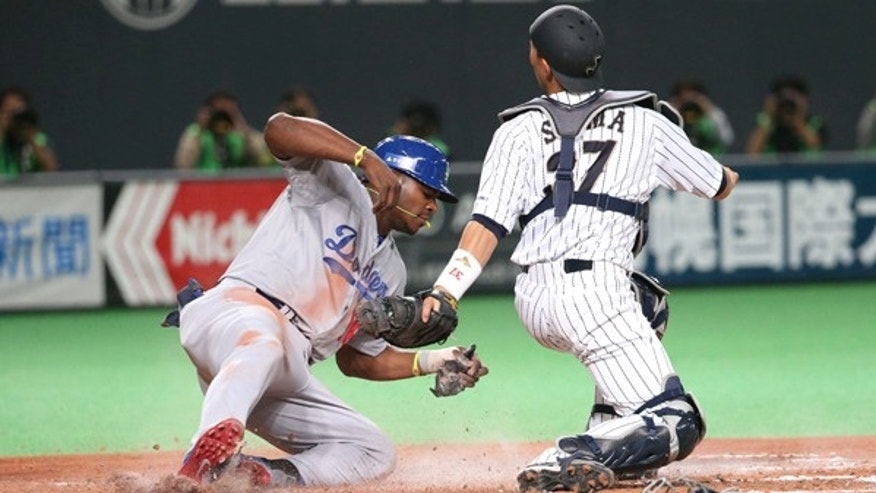 SAPPORO, JAPAN - NOVEMBER 18:  Motohiro Shima #37 of Samurai Japan sets to put the tag on Yasiel Puig #66 of the Los Angeles Dodgers during the game five of Samurai Japan and MLB All Stars at Sapporo Dome on November 18, 2014 in Sapporo, Hokkaido, Japan.  (Photo by Atsushi Tomura/Getty Images)