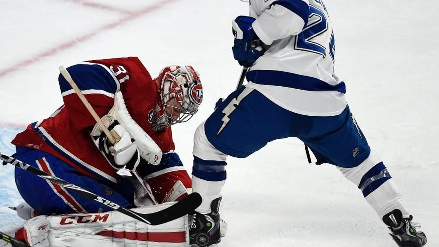 Montreal Canadiens goalie Carey Price (31) stops Tampa Bay Lightning right wing Ryan Callahan (24) during the second period of an NHL hockey game Tuesday, March 10, 2015, in Montreal. (AP Photo/The Canadian Press, Ryan Remiorz)