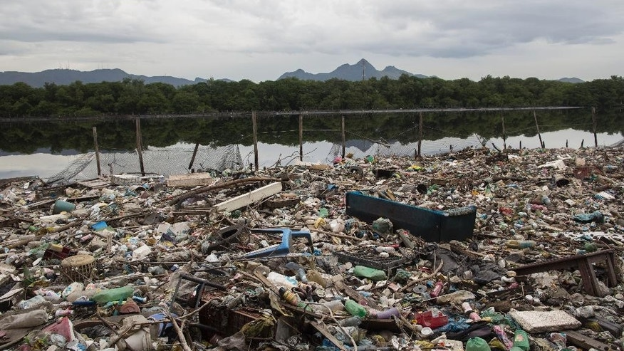 Trash floats on a polluted water channel that flows into the Guanabara Bay during a tour for the foreign press in Rio de Janeiro, Brazil, Tuesday, March 10, 2015. The government of Rio de Janeiro is turning to Dutch experts for help in cleaning up the trash-filled bay in time for the 2016 Olympics' sailing events. But environmentalists say the government is not doing enough to fix rampant sewage pollution and that the trash tracking will have zero impact on that. (AP Photo/Felipe Dana)