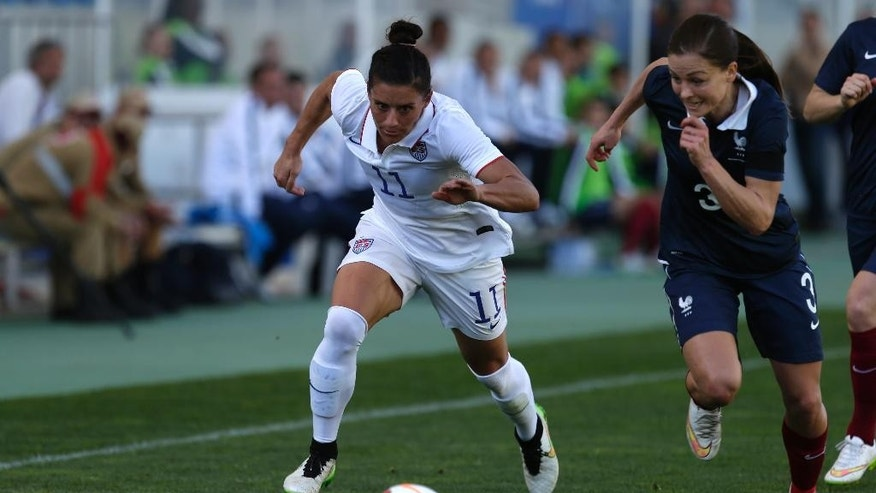 Ali Krieger, left, of the US, vies for the ball with France's Laura Boulleau during the women's soccer Algarve Cup final match between US and France at the Algarve stadium, outside Faro, southern Portugal, Wednesday, March 11, 2015. (AP Photo/Francisco Seco)