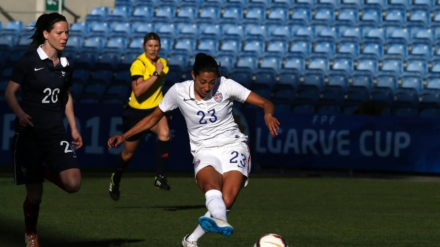 Christen Press, of the US, shoots the ball to score her side's second goal against France, during the women's soccer Algarve Cup final match between US and France at the Algarve stadium, outside Faro, southern Portugal, Wednesday, March 11, 2015. (AP Photo/Francisco Seco)
