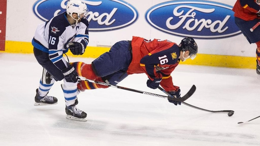 After colliding with Winnipeg Jets' Andrew Ladd (16), Florida Panthers' Aleksander Barkov (16) falls to the ice during the second period of an NHL hockey game in Sunrise, Fla., Thursday, March 12, 2015. (AP Photo/J Pat Carter)