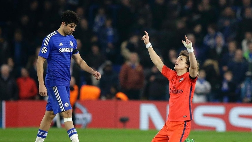 PSG's David Luiz, right, celebrates at the final whistle as Chelsea's Diego Costa, right, leaves the field after the Champions League round of 16 second leg soccer match between Chelsea and Paris Saint Germain at Stamford Bridge stadium in London, Wednesday, March 11, 2015. The ended in a 2-2 draw with PSG going through on away goals.  (AP Photo/Matt Dunham)