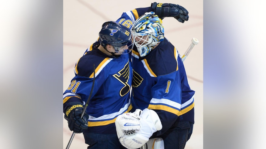 St. Louis Blues' goalie Brian Elliott (1) is congratulated by teammate Vladimir Tarasenko (91), of Russia, after their shootout victory over the Philadelphia Flyers in an NHL hockey game, Thursday, March 12, 2015, in St. Louis. (AP Photo/Bill Boyce)