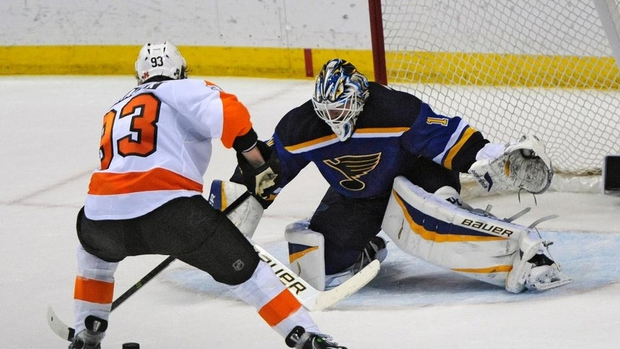 St. Louis Blues' goalie Brian Elliott (1) blocks a shot in a shootout by Philadelphia Flyers' Jakub Voracek (93), of Czech Republic, in an NHL hockey game, Thursday, March 12, 2015, in St. Louis. (AP Photo/Bill Boyce)