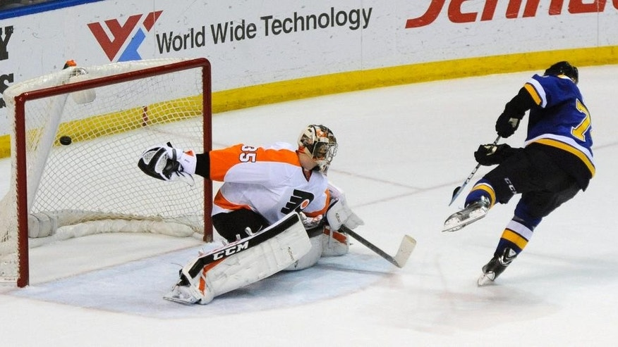St. Louis Blues' T.J. Oshie, right, scores in a shootout against Philadelphia Flyers' goalie Steve Mason (35) during in an NHL hockey game, Thursday, March 12, 2015, in St. Louis. (AP Photo/Bill Boyce)