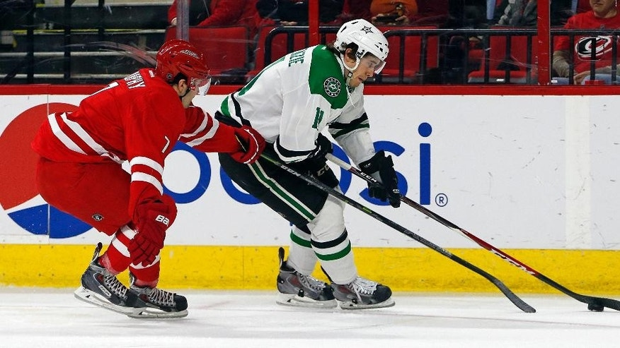 Dallas Stars' Curtis McKenzie (11) battles with Carolina Hurricanes' Ryan Murphy (7) during the first period of an NHL hockey game, Thursday, March 12, 2015, in Raleigh, N.C. (AP Photo/Karl B DeBlaker)