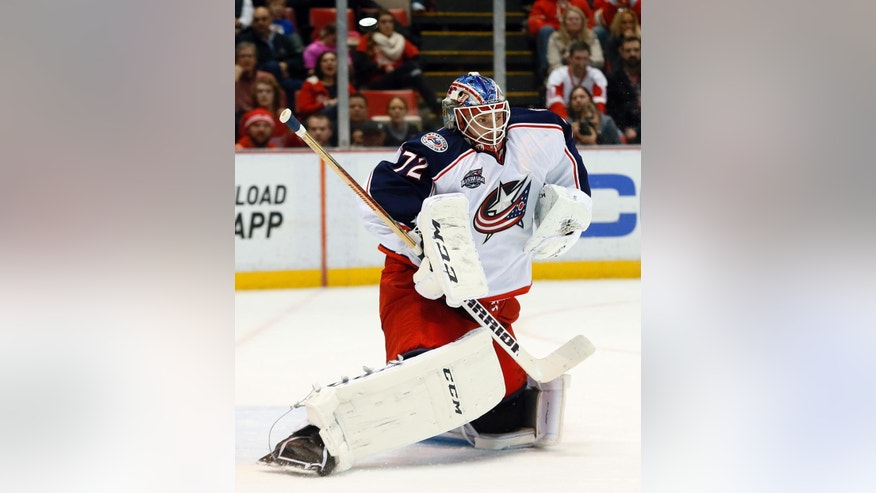 Columbus Blue Jackets goalie Sergei Bobrovsky (72) stops a Detroit Red Wings shot in the second period of an NHL hockey game in Detroit Thursday, March 12, 2015. (AP Photo/Paul Sancya)