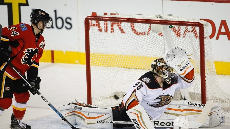 Anaheim Ducks goalie John Gibson, right, lets in a goal as Calgary Flames Jiri Hudler, from the Czech Republic, looks on during second period NHL hockey action in Calgary, Alberta, Wednesday, March 11, 2015.  (AP Photo/The Canadian Press, Jeff McIntosh)