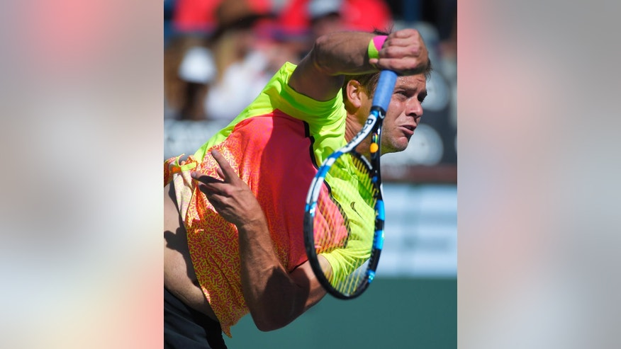Ryan Harrison serves to Mardy Fish during their match at the BNP Paribas Open tennis tournament, Thursday, March 12, 2015, in Indian Wells, Calif. (AP Photo/Mark J. Terrill)