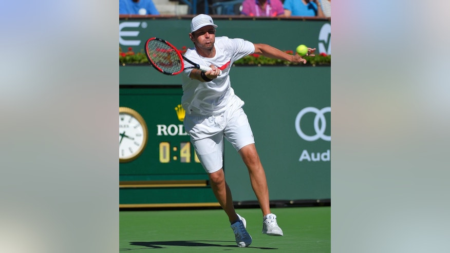 Mardy Fish returns to Ryan Harrison during their match at the BNP Paribas Open tennis tournament, Thursday, March 12, 2015, in Indian Wells, Calif. (AP Photo/Mark J. Terrill)